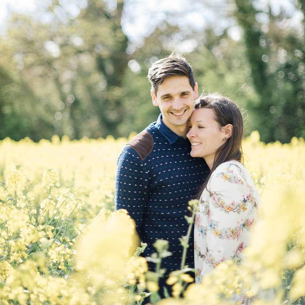oil seed rape field couple love